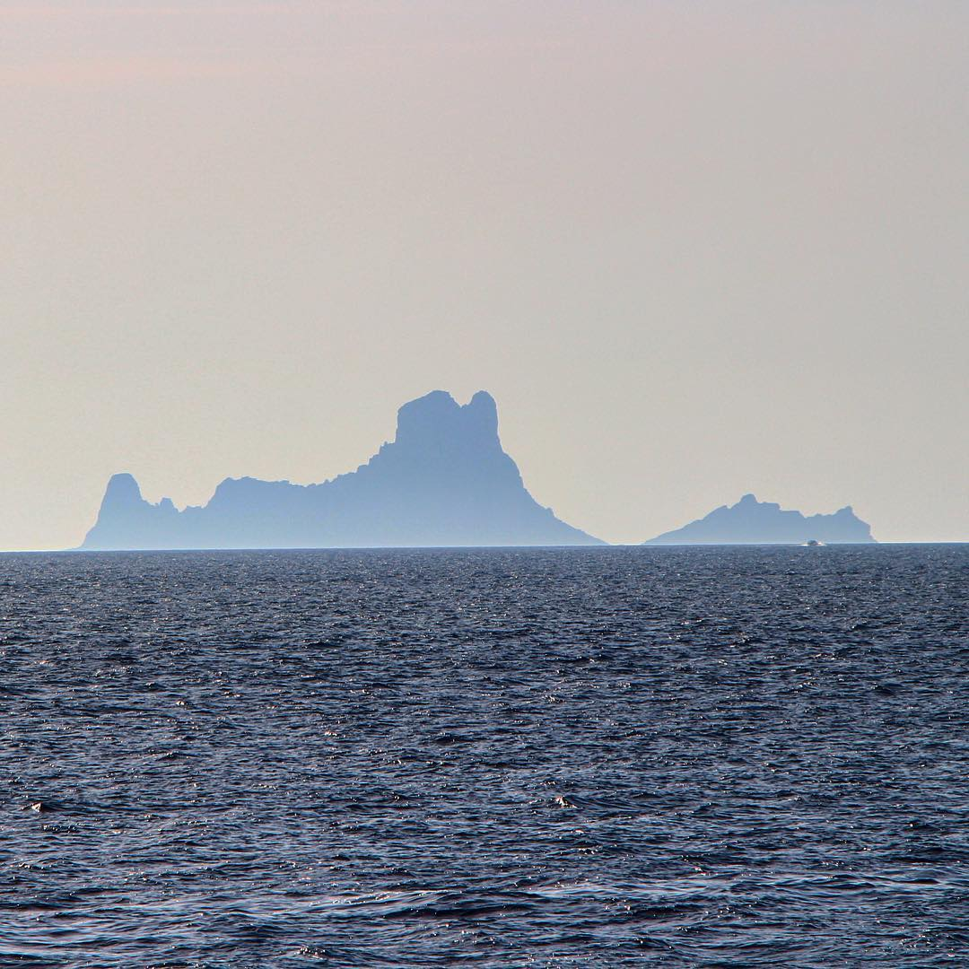 Es Vedrà from the Formentera perspective in light pastel shades⛰ #esvedra #formetera #pastel #pasteldhades #lightblue #magicrock #magicesvedra #ocean #ibizadiary #magicisland #differentperspective #silhouette #islasbaleares #baleares #ibiza2018 #formentera2018 #formenteralovers #magicesvedra #oceanrocks, Es Vedrà